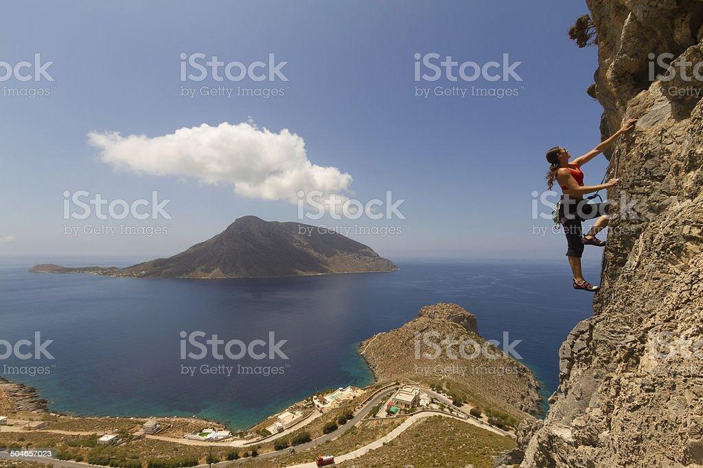 Woman rockclimbing in Kalymnos royalty-free stock photo