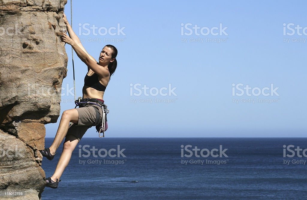 Woman rockclimbing royalty-free stock photo