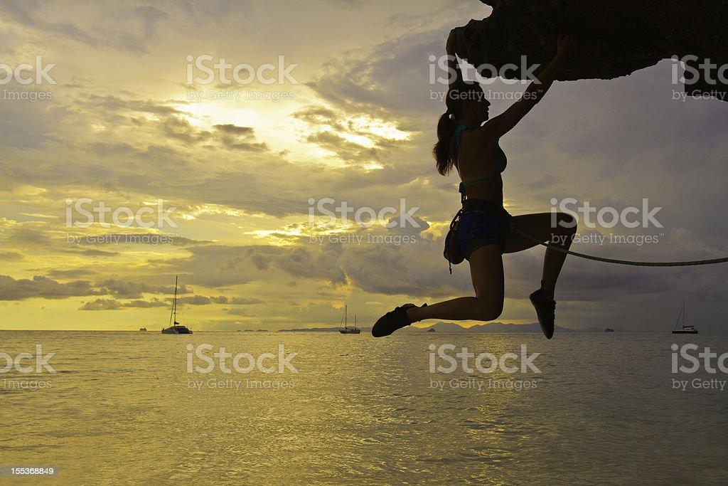 Woman rockclimbing silhouette royalty-free stock photo