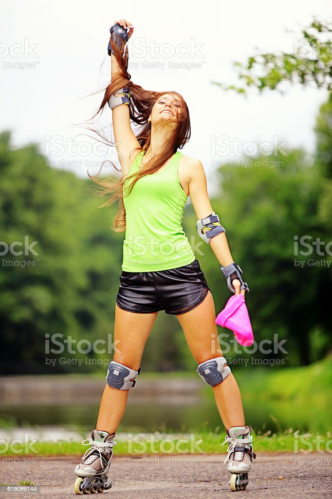 woman roller skating sport activity in park stock photo