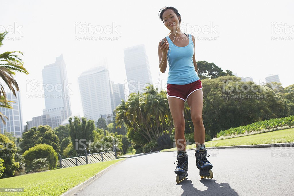 Woman rollerblading in urban park royalty-free stock photo