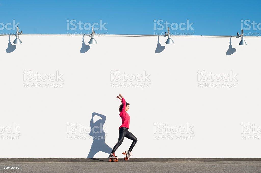Woman rollerblading stock photo