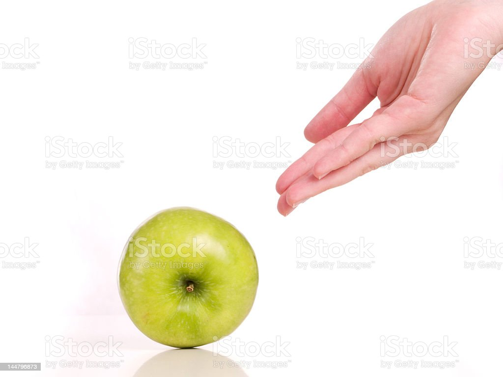 woman rolling a green apple royalty-free stock photo