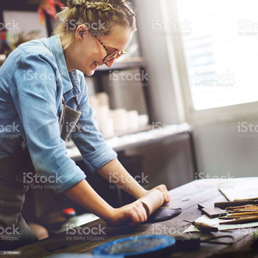 Woman Rolling Clay Craftsman Skill Concept stock photo