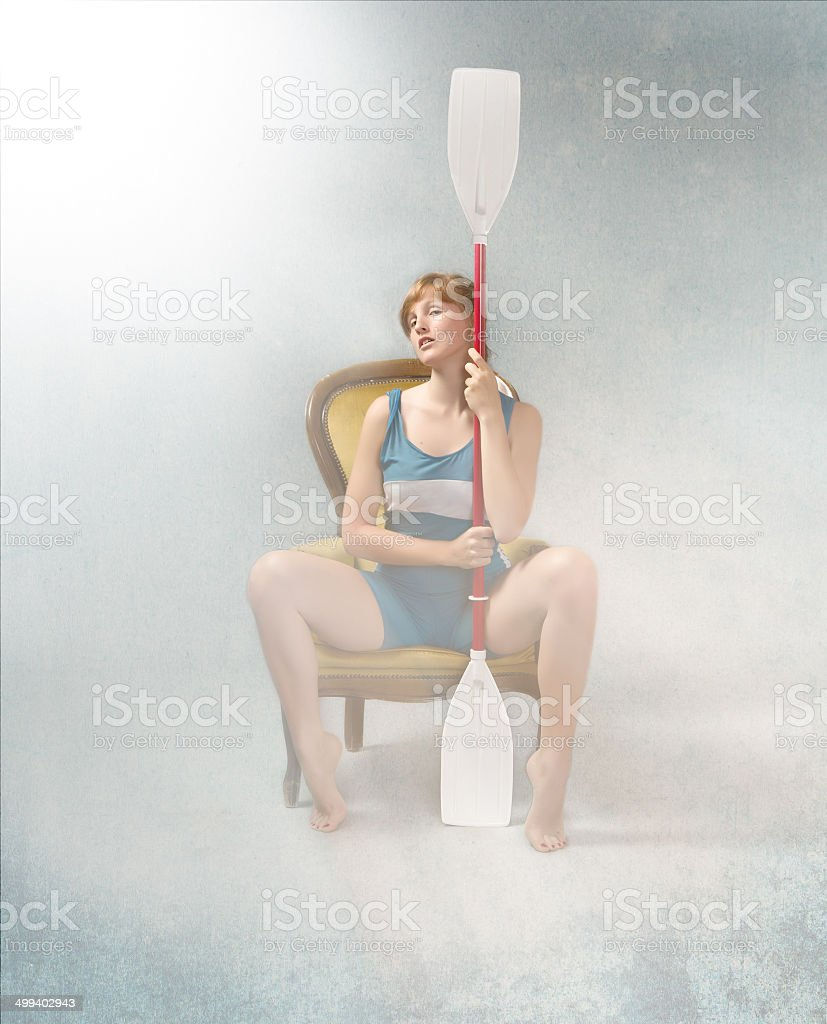 woman rower ready for competition with oar stock photo