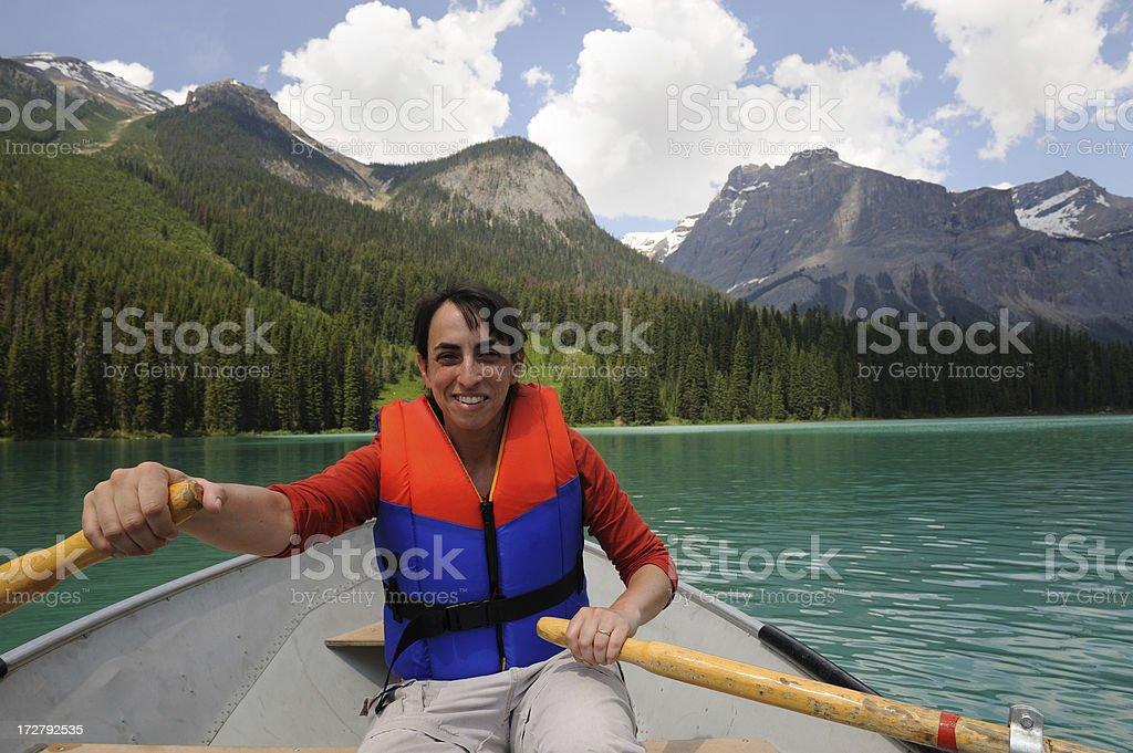 Woman Rowing Boat on Mountain Lake royalty-free stock photo
