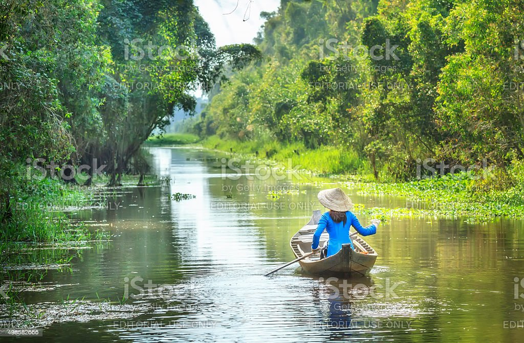 Woman rowing on the River Country stock photo