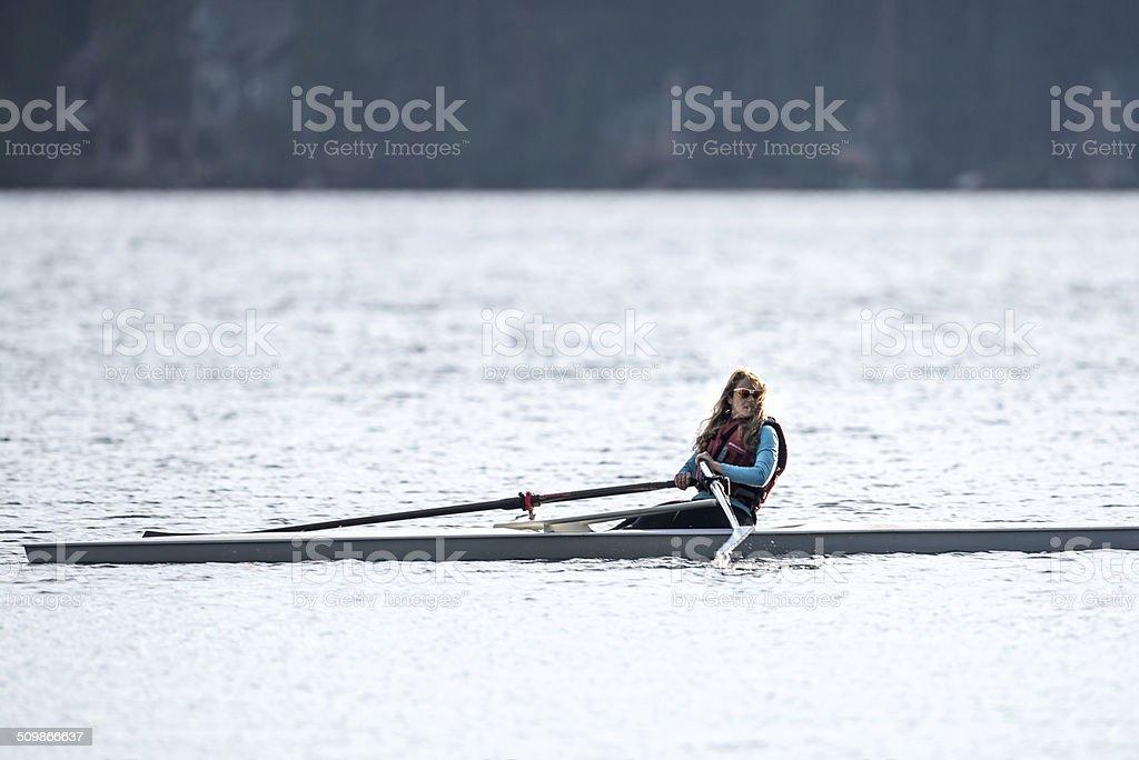 Woman Rowing stock photo
