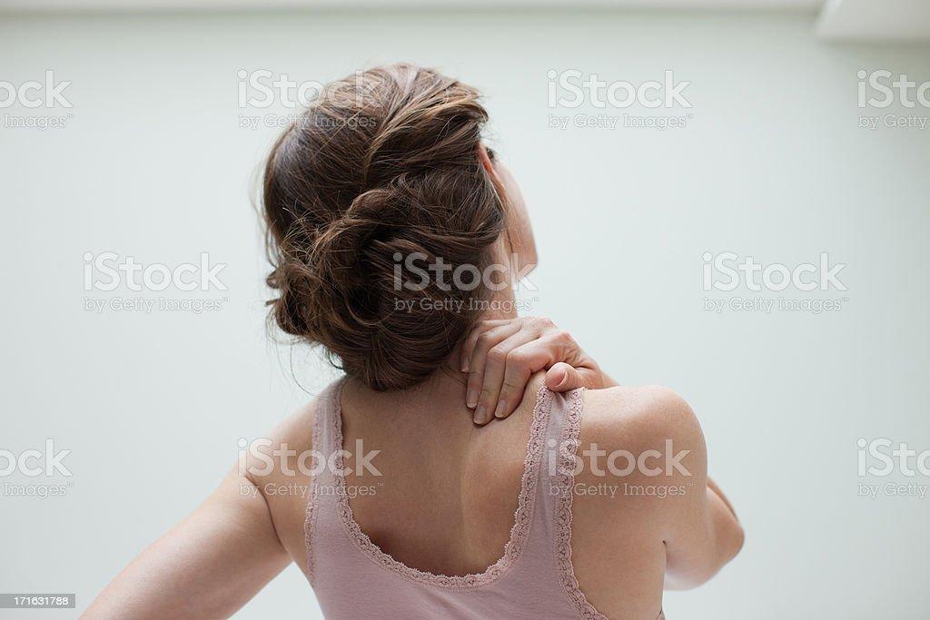 Woman rubbing aching back stock photo