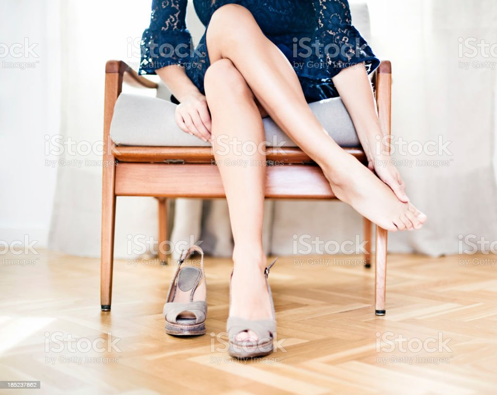 Woman rubbing foot stock photo