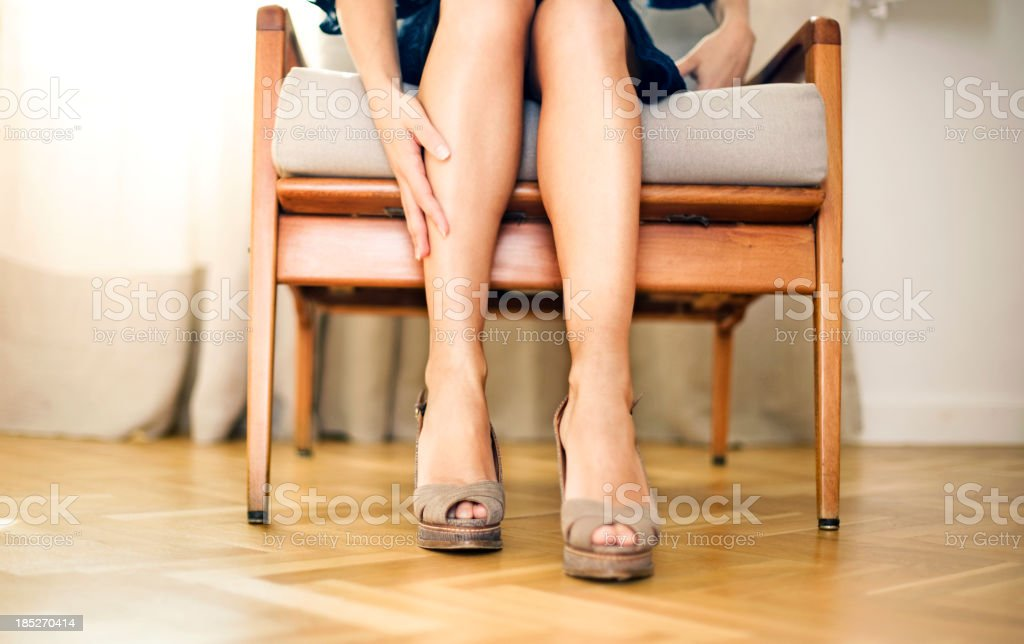 Woman rubbing knee royalty-free stock photo
