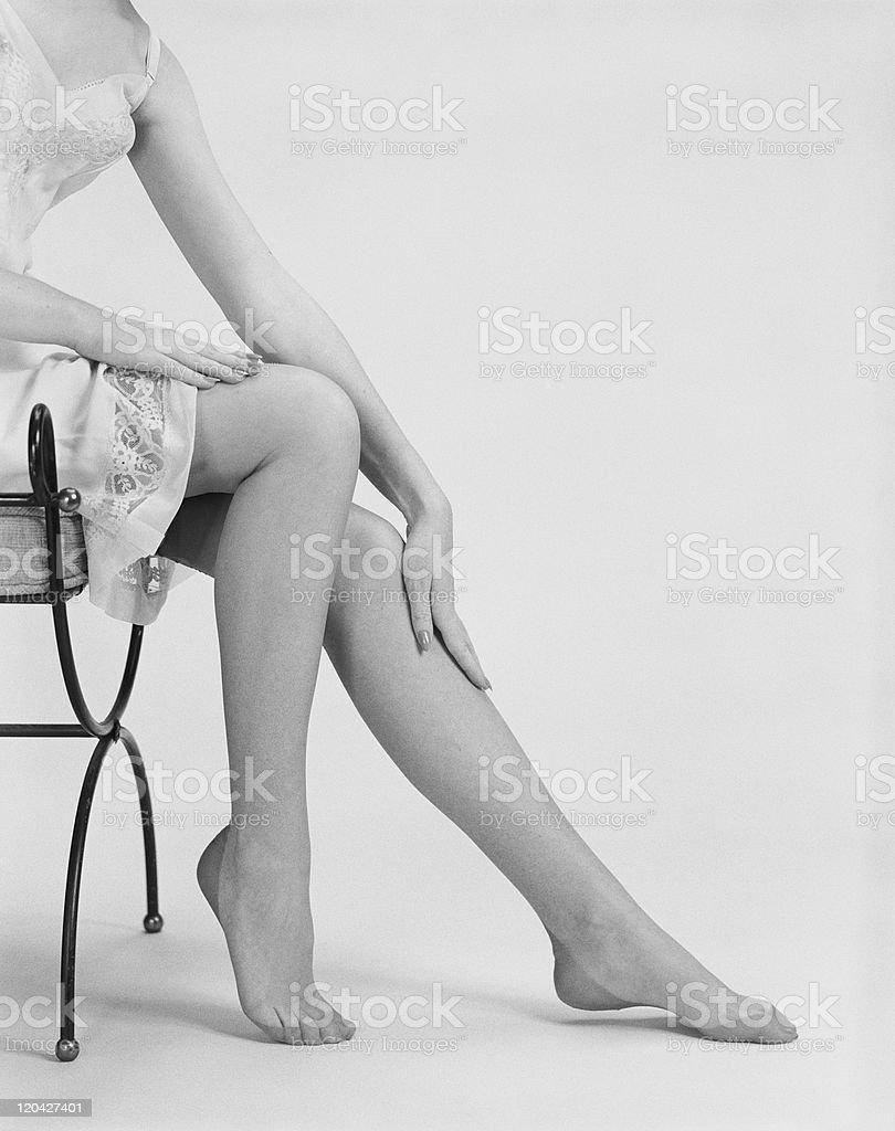 Woman rubbing legs stock photo