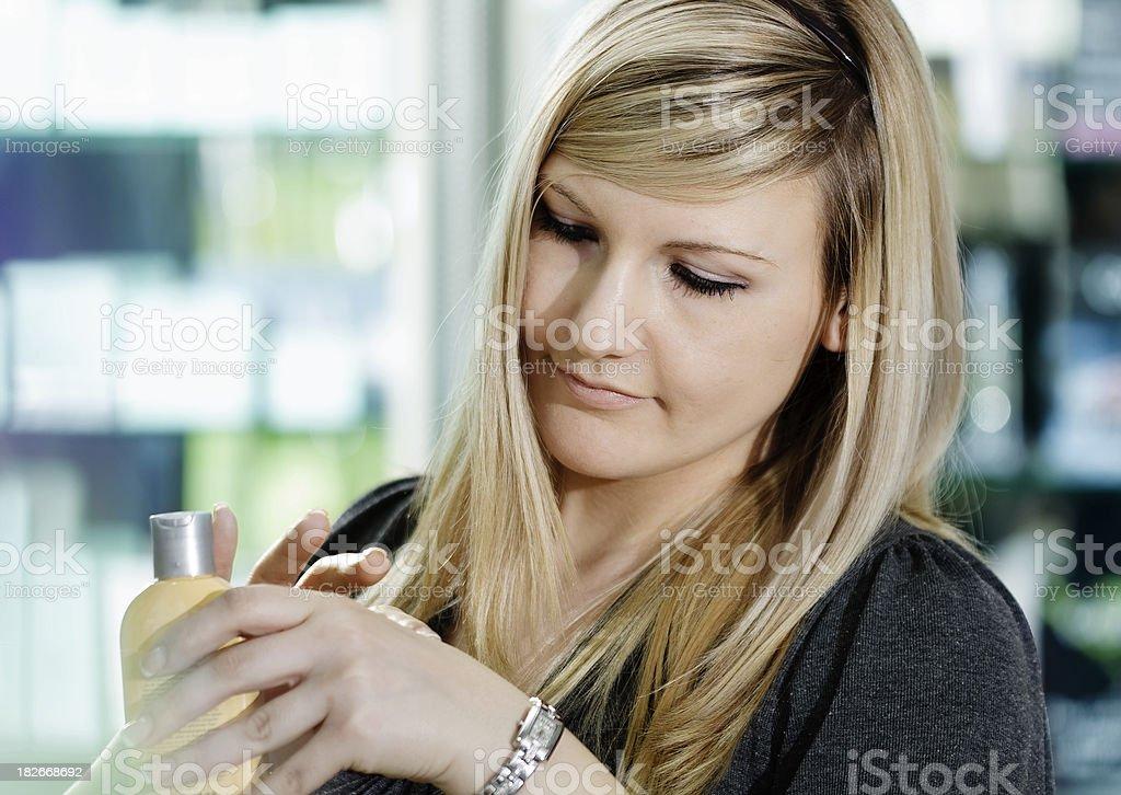 Woman Rubbing On Hand Cream royalty-free stock photo