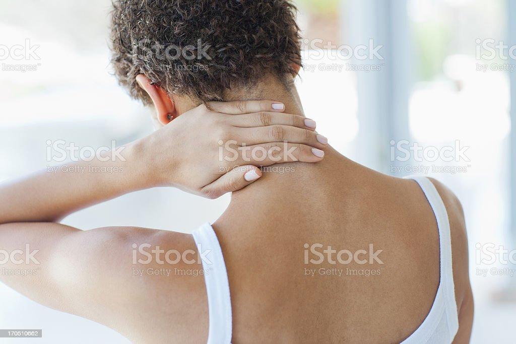Woman rubbing sore neck stock photo