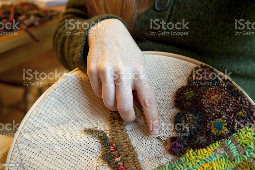 Woman Rug Hooking stock photo