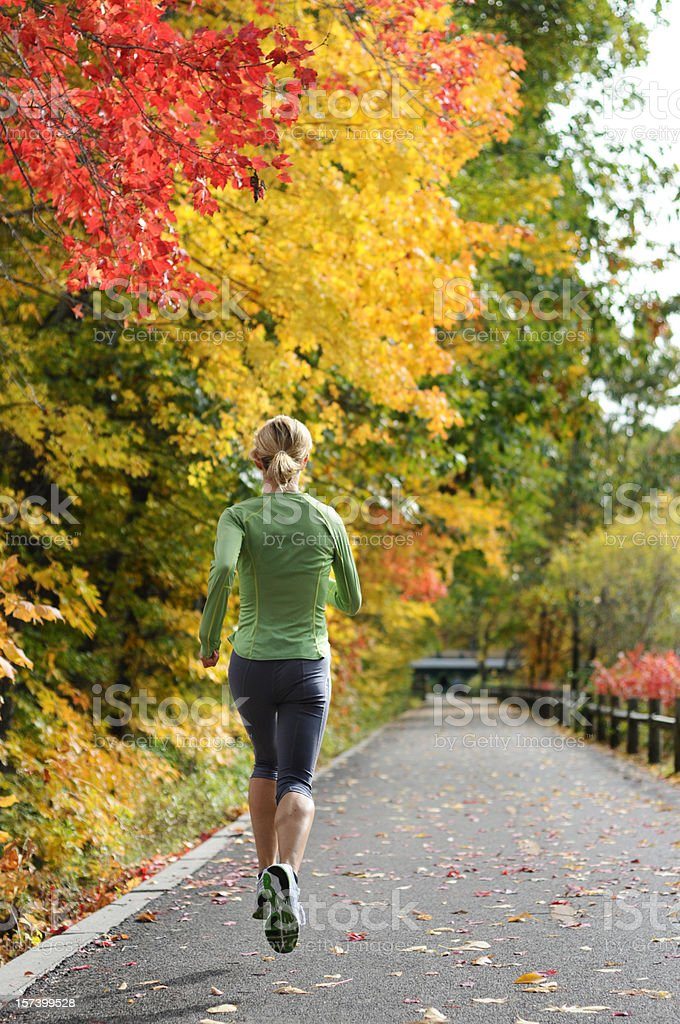 woman Runner in Fall royalty-free stock photo