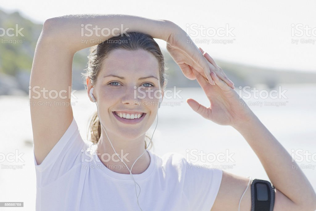Woman runner listening to mp3 player royalty-free stock photo