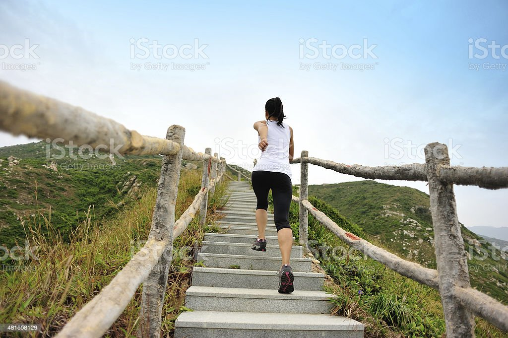 woman runner mountain stairs stock photo