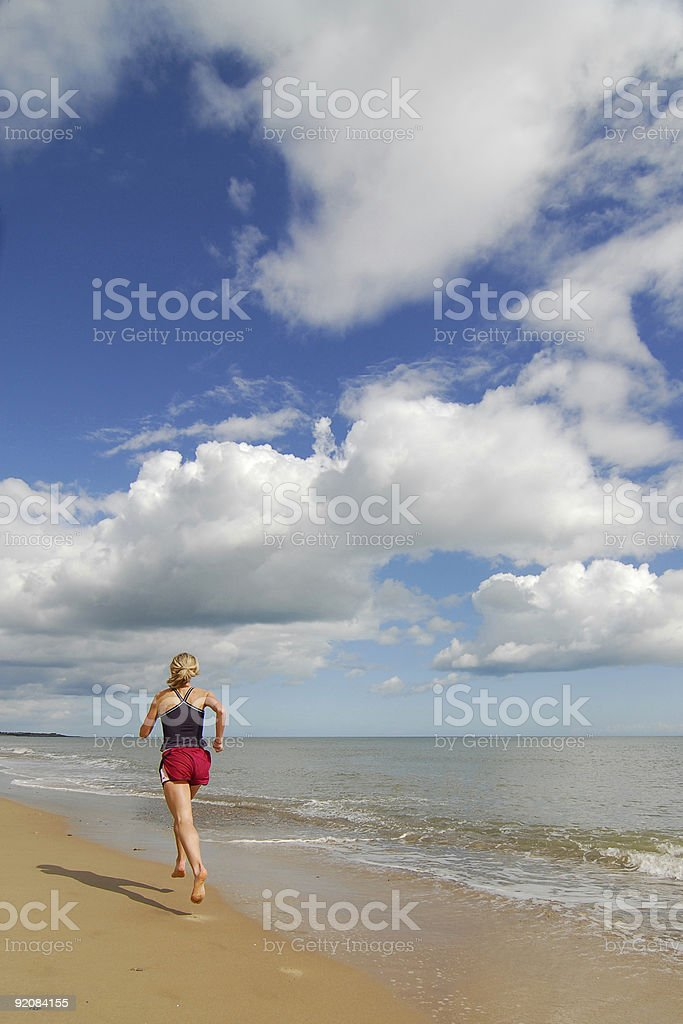 Woman Runner on Beach royalty-free stock photo
