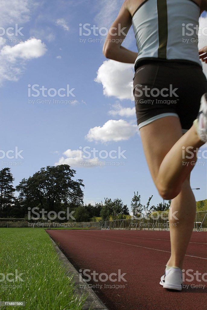 Woman Runner on Track royalty-free stock photo