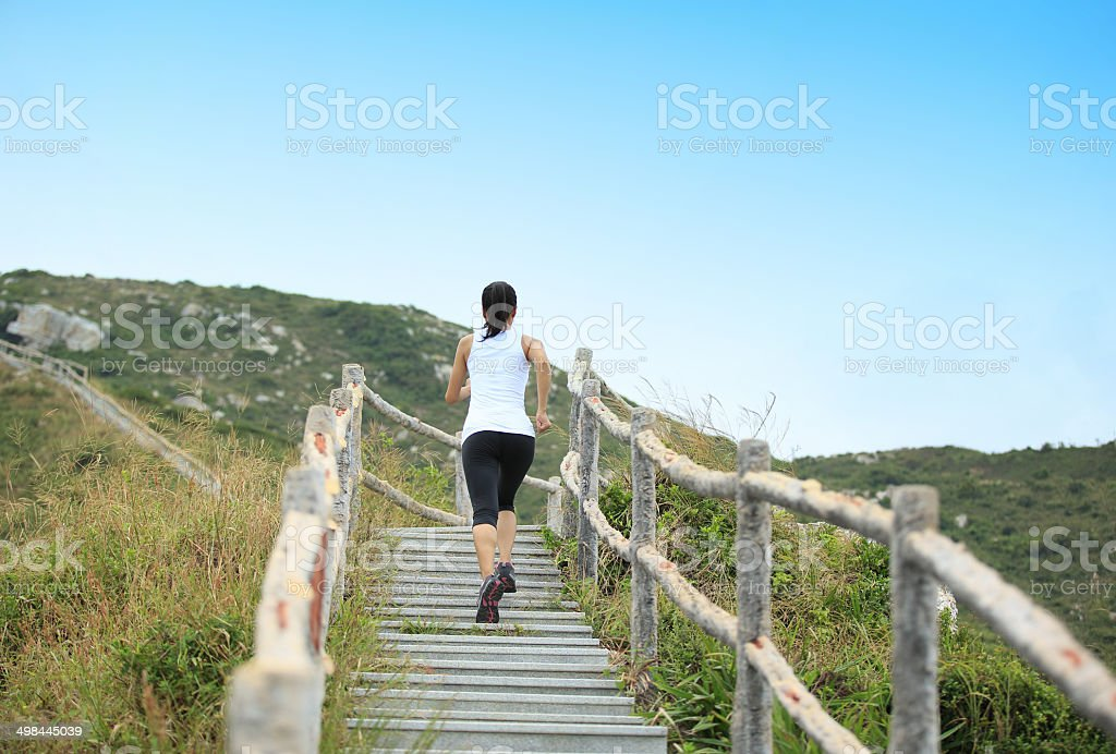 woman runner running at mountain stairs royalty-free stock photo