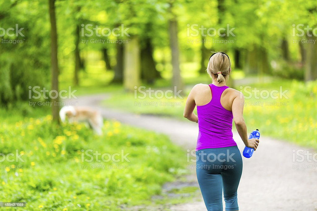 Woman runner running jogging in summer park stock photo
