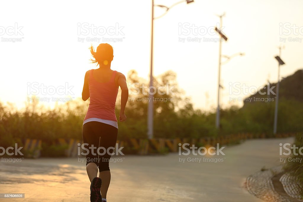 woman runner sunrise stock photo