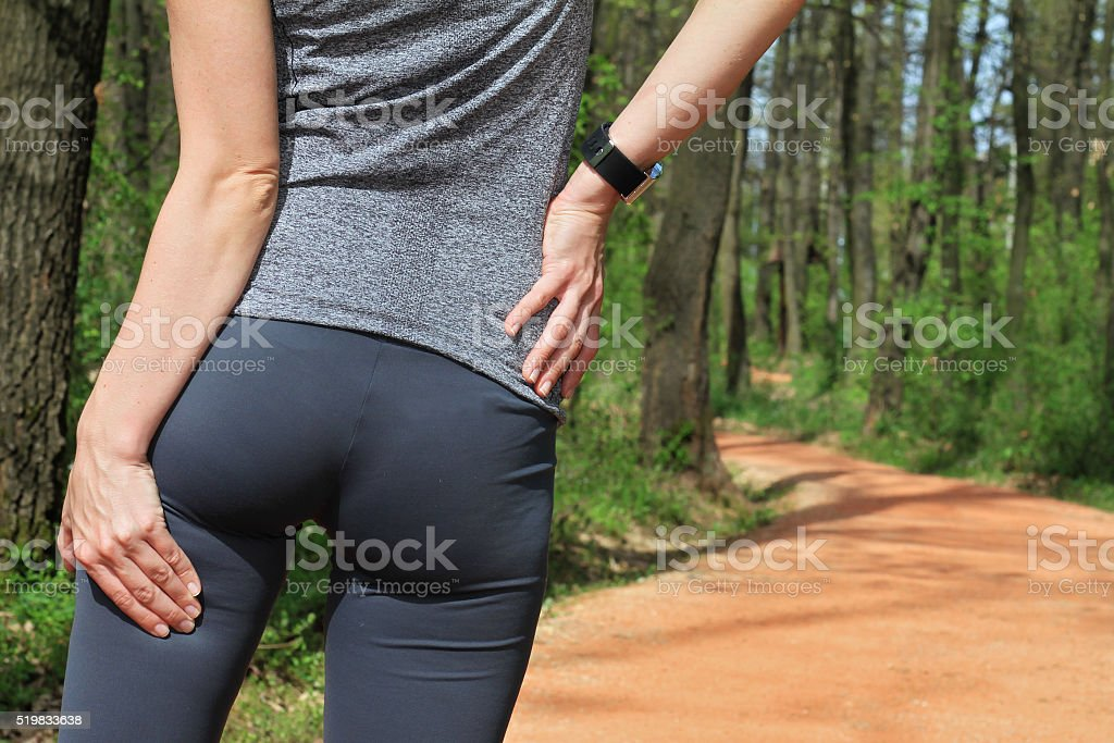 Woman  runner with Cramp in the Hamstring Muscles stock photo