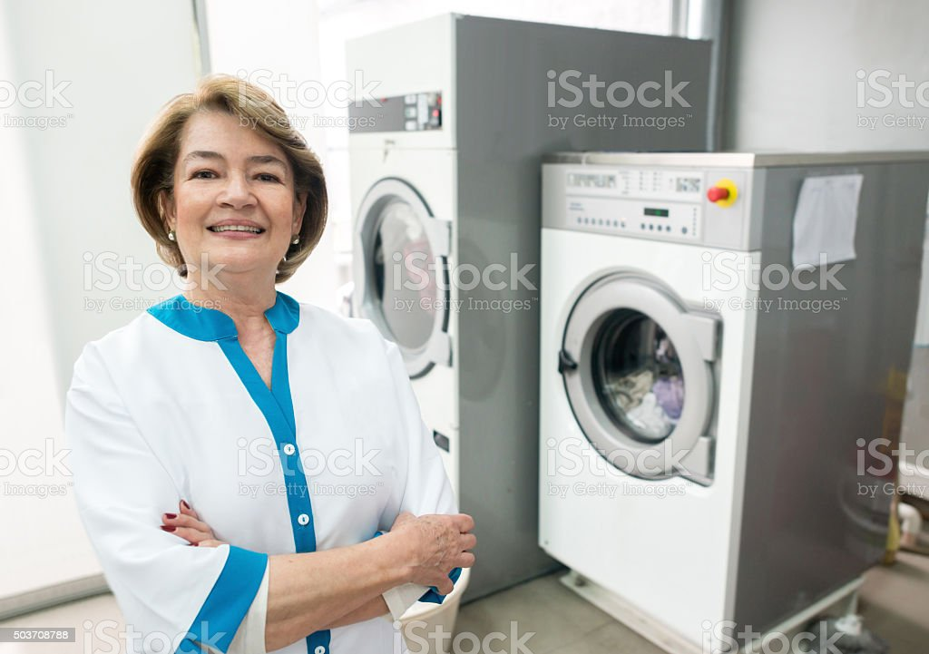 Woman running a laundry service shop stock photo