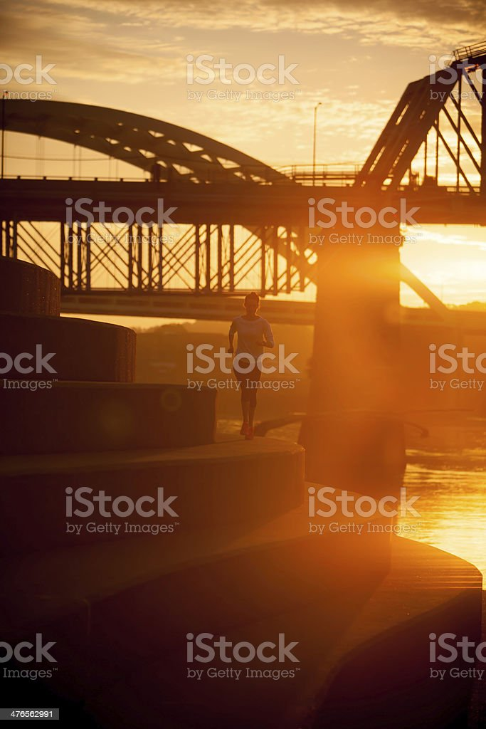 Woman running along Ohio River in Cincinnati stock photo