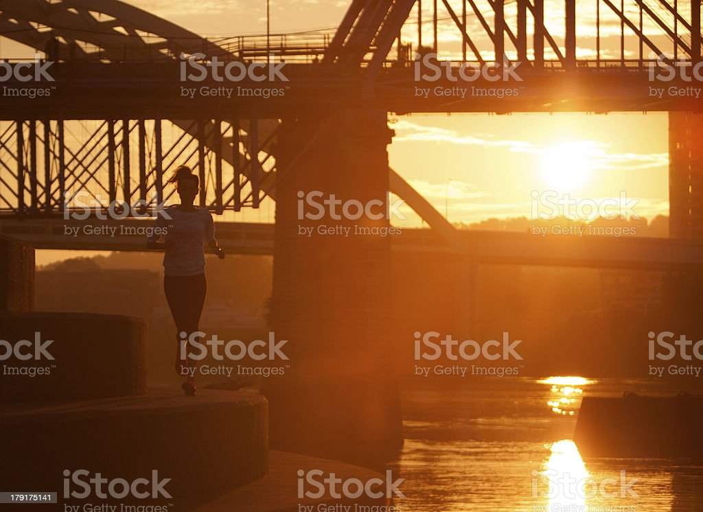 Woman running along Ohio River in downtown Cincinnati. royalty-free stock photo