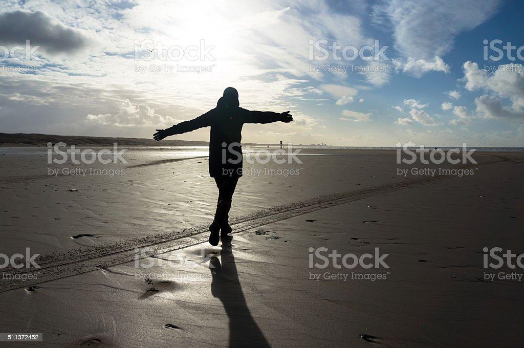 Woman running beach stock photo