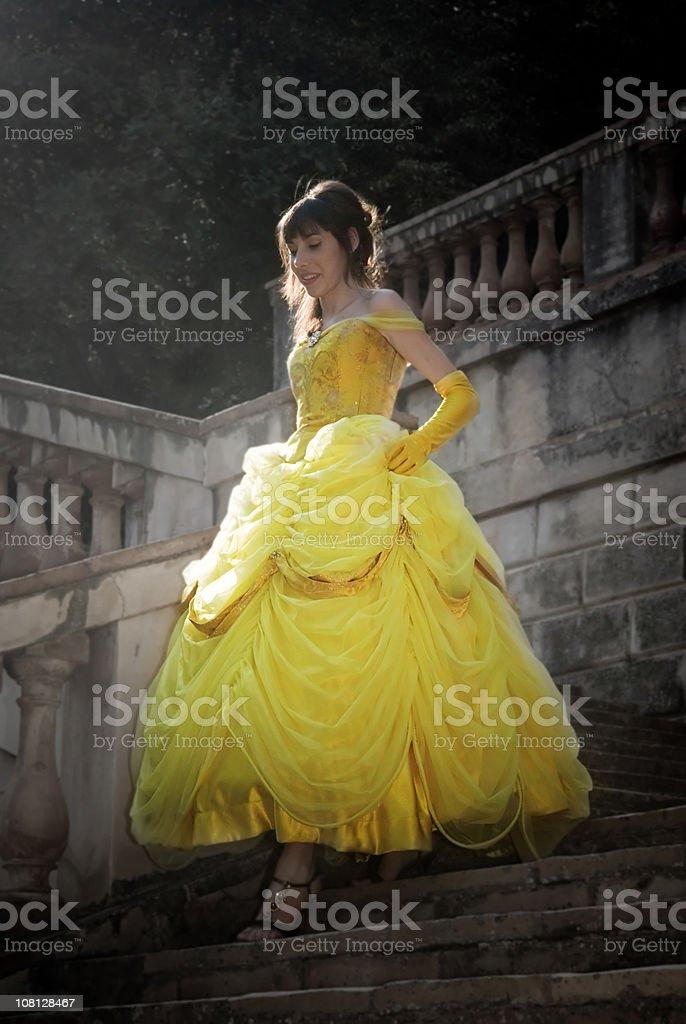 Woman Running Down Stairs stock photo
