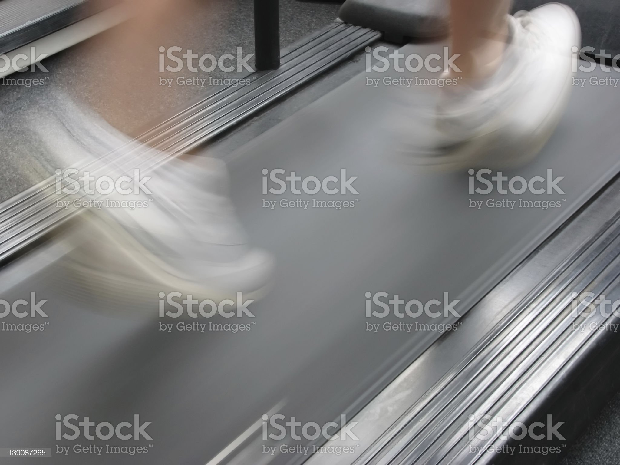 A woman running fast on a treadmill royalty-free stock photo