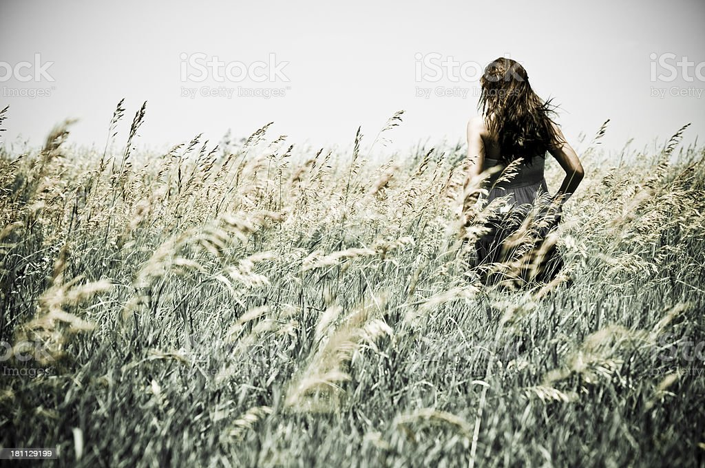 Woman Running in a Field royalty-free stock photo