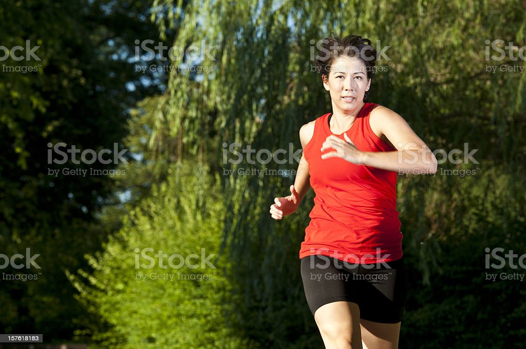 Woman Running in a Park royalty-free stock photo
