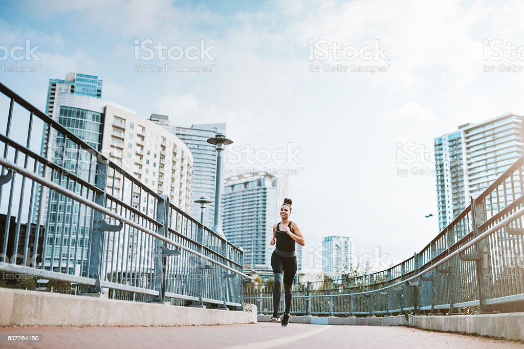 Woman Running in Downtown Austin stock photo