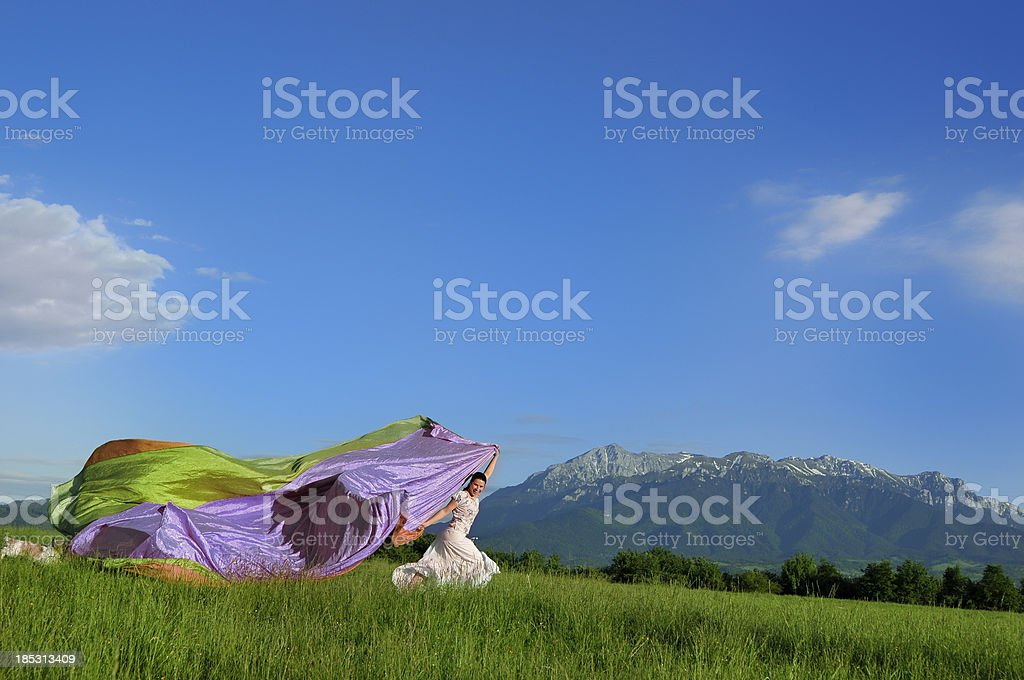 woman running in field royalty-free stock photo