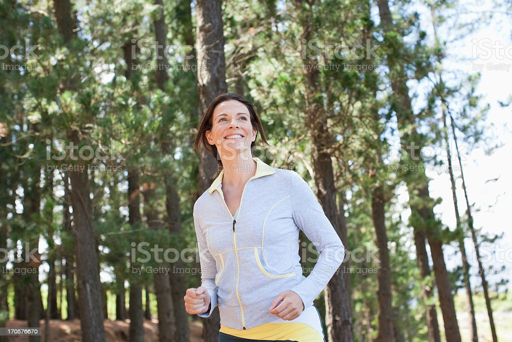 Woman running in forest royalty-free stock photo