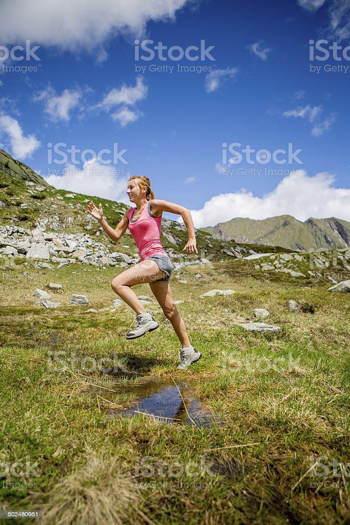 Woman running in nature stock photo