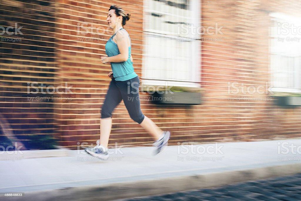 Woman Running in New York stock photo