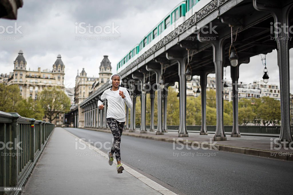 Woman running in Paris stock photo