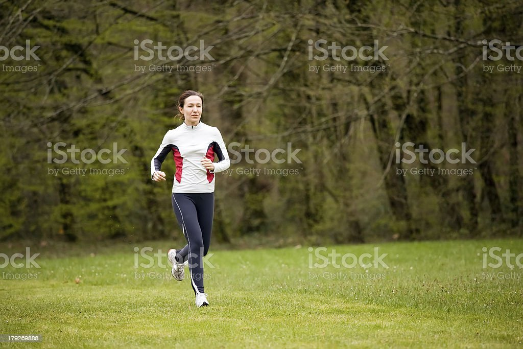 woman running in park royalty-free stock photo
