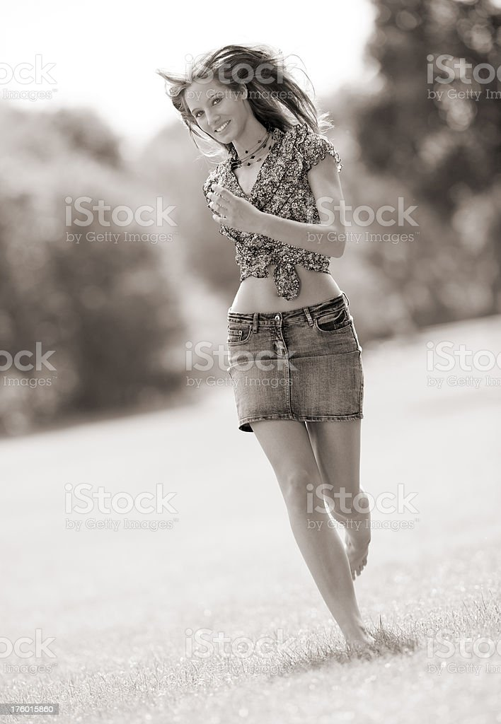 Woman running in park with a perfect candid smile stock photo