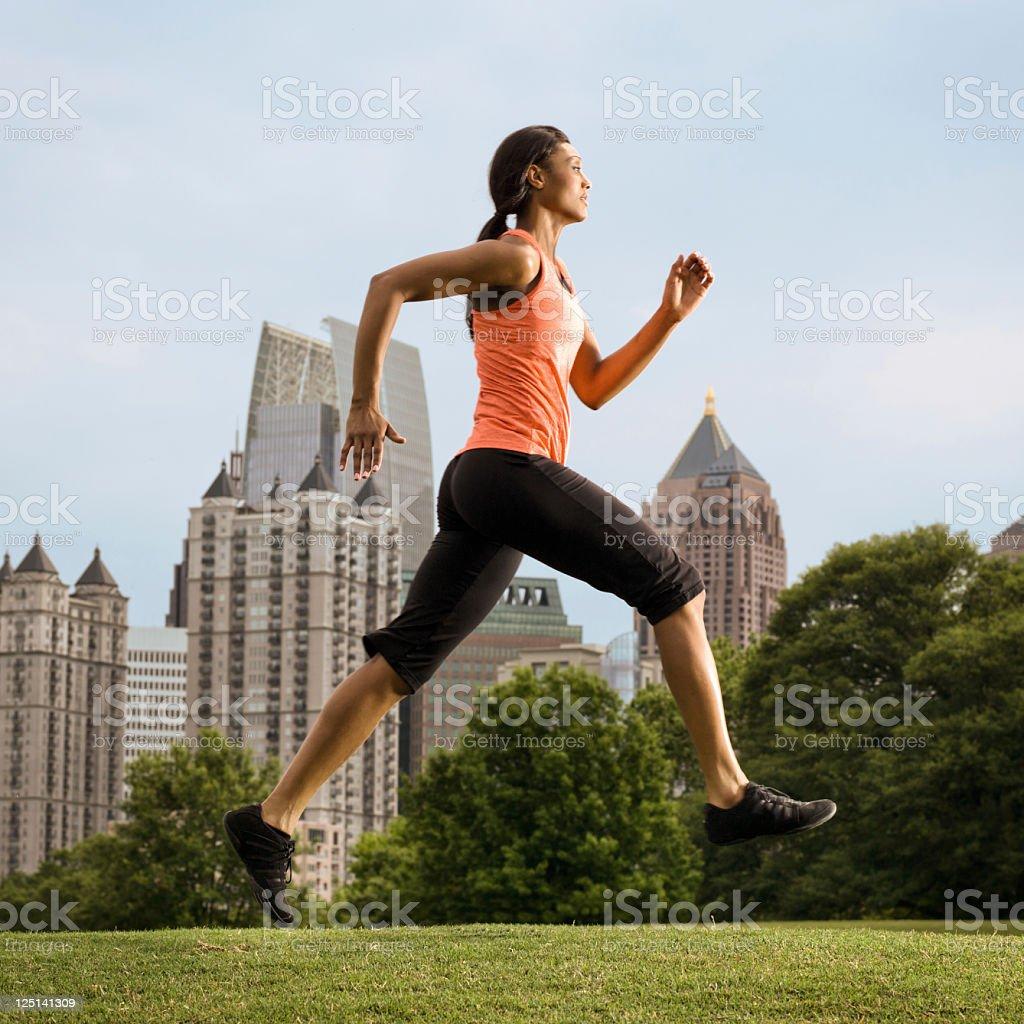 Woman running in Piedmont Park, Atlanta, Georgia US royalty-free stock photo