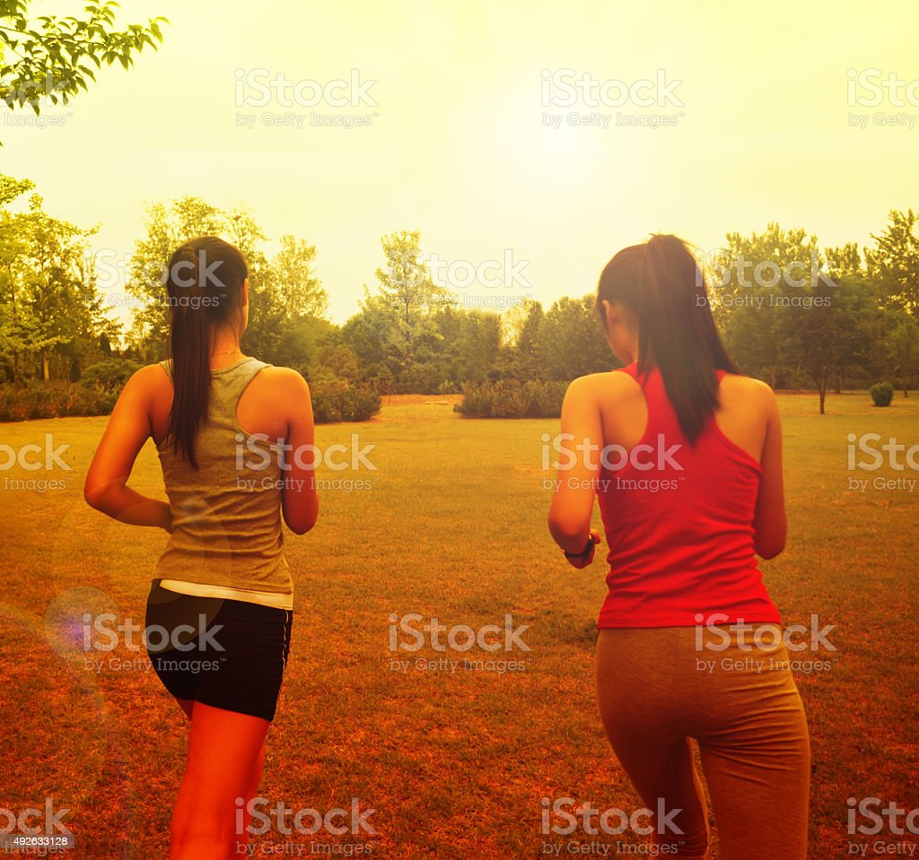 Woman running in the sunshine stock photo