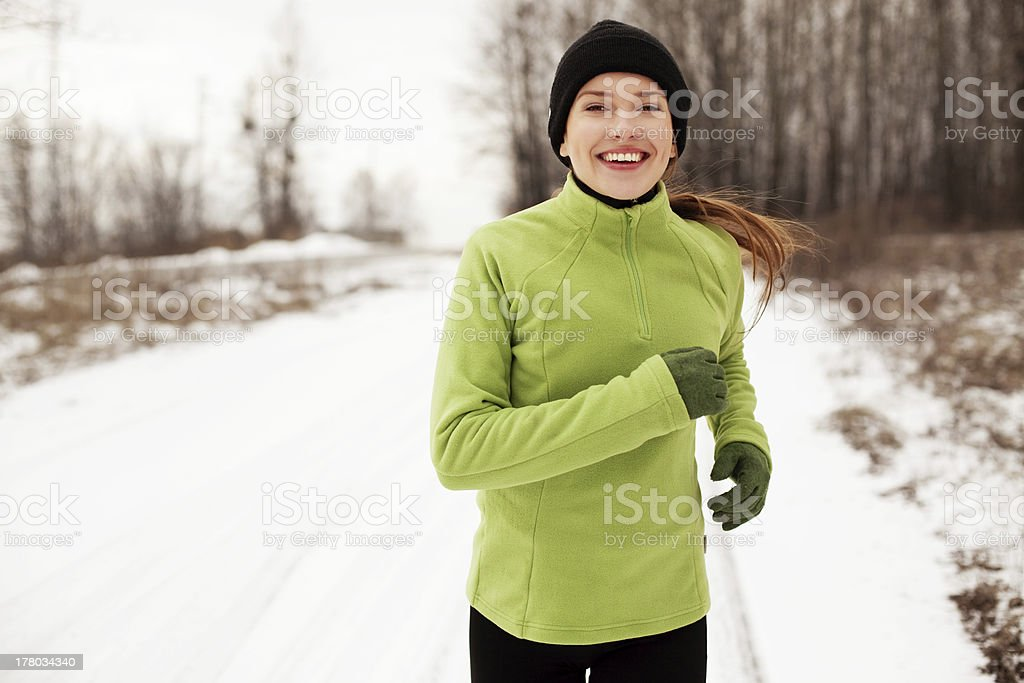 Woman running in winter royalty-free stock photo