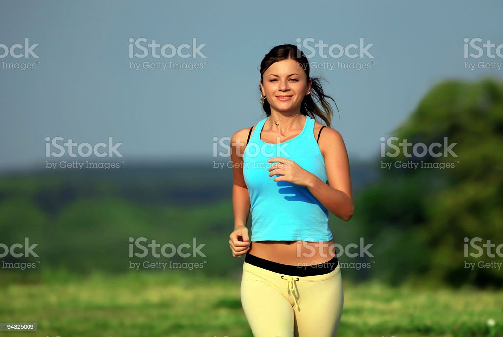 woman running on a sunny day royalty-free stock photo