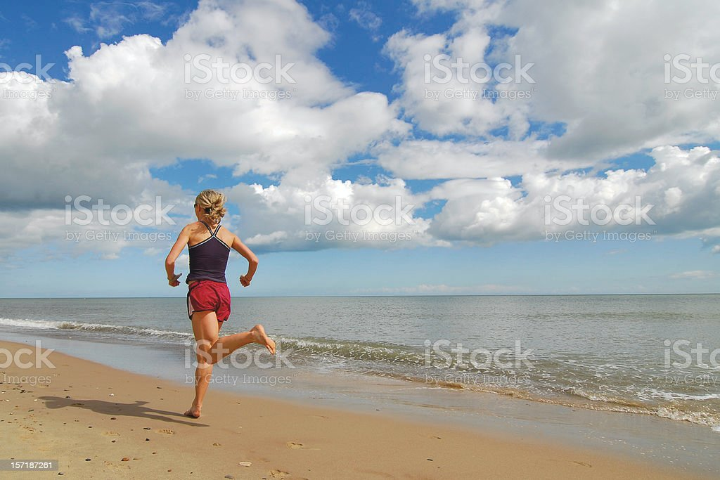 Woman Running on Beach royalty-free stock photo