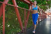 Woman running on footbridge